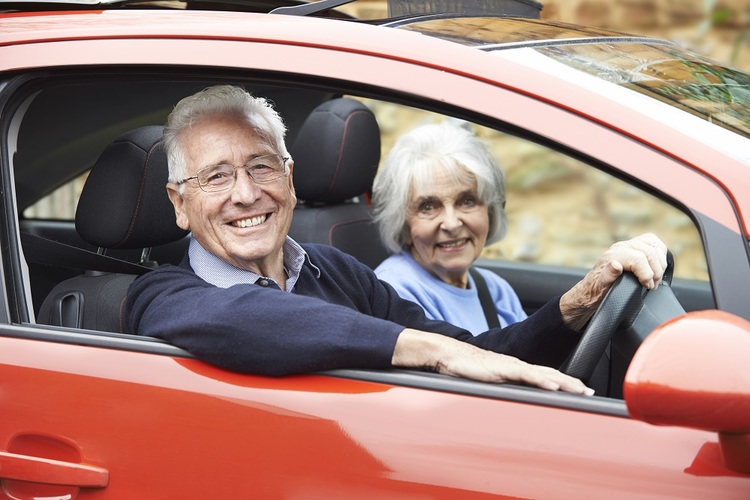 Elderly Couple Driving Car